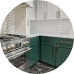 Emerald green kitchen cabinets by Southern Green Builders in Houston